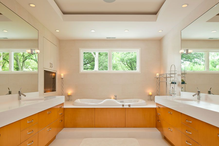 Contemporary Master Bathroom with Standard height, Undermount sink, Wall Tiles, Flush, can lights, Corian counters, Casement