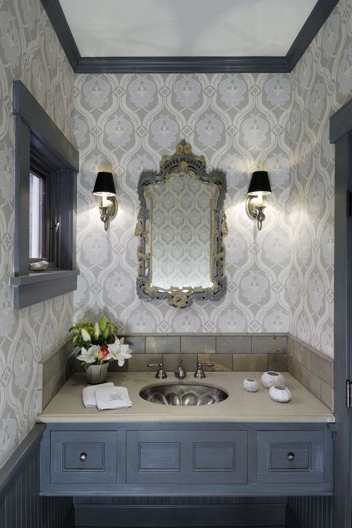 Traditional Powder Room with Stone Tile, interior wallpaper, Undermount sink, Corian counters, partial backsplash, Casement