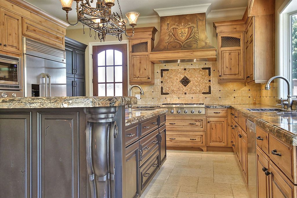 Traditional Kitchen with U-shaped, Large Ceramic Tile, Raised panel, French doors, Crown molding, Custom hood, Chandelier