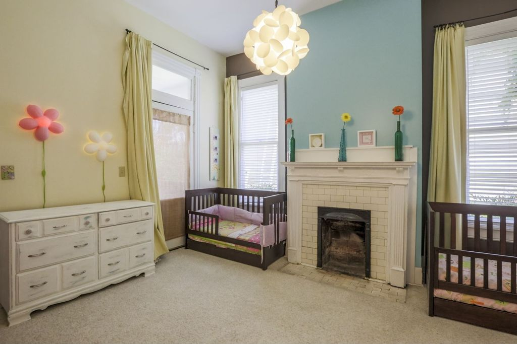 Modern Kids Bedroom with brick fireplace, Glass panel door, Ikea smila bloomma wall lamp pink, Chandelier, Paint, Fireplace