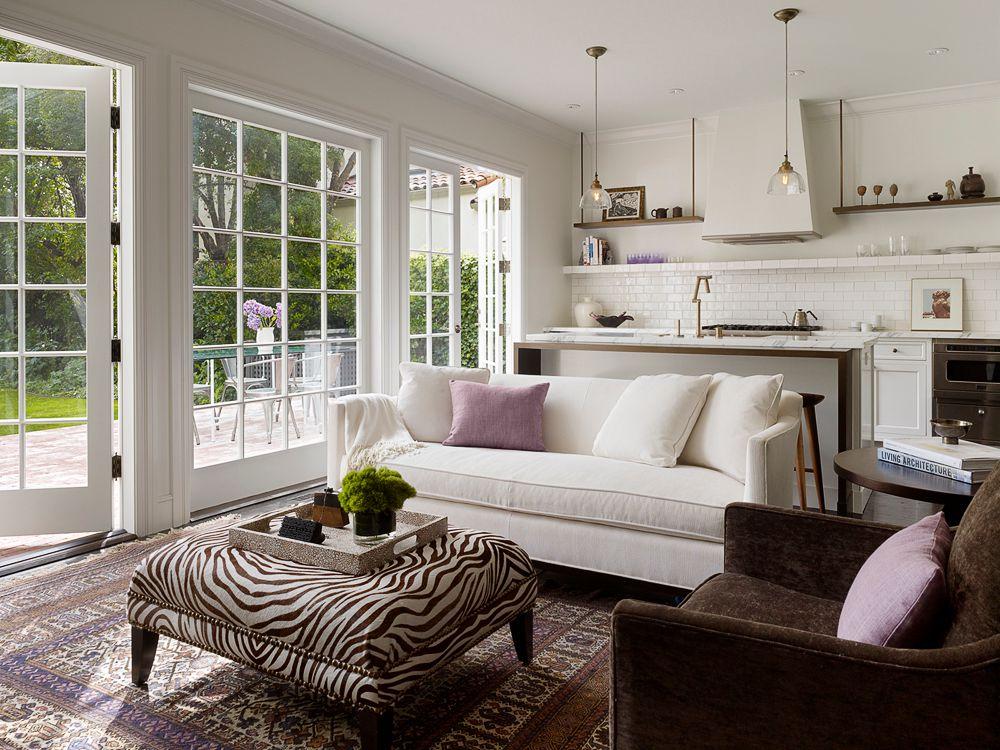 Contemporary Living Room with Crown molding, Pendant light, interior brick, Carpet, Standard height, Built-in bookshelf
