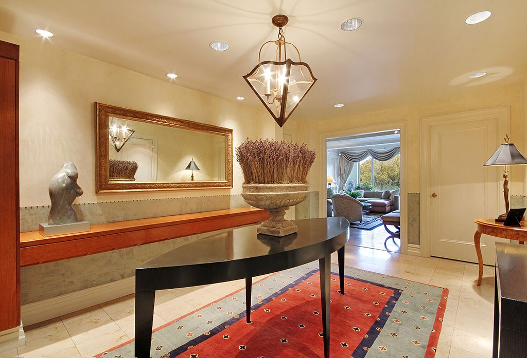 Traditional Entryway with can lights, Standard height, stone tile floors, flat door, sandstone tile floors, Wainscotting