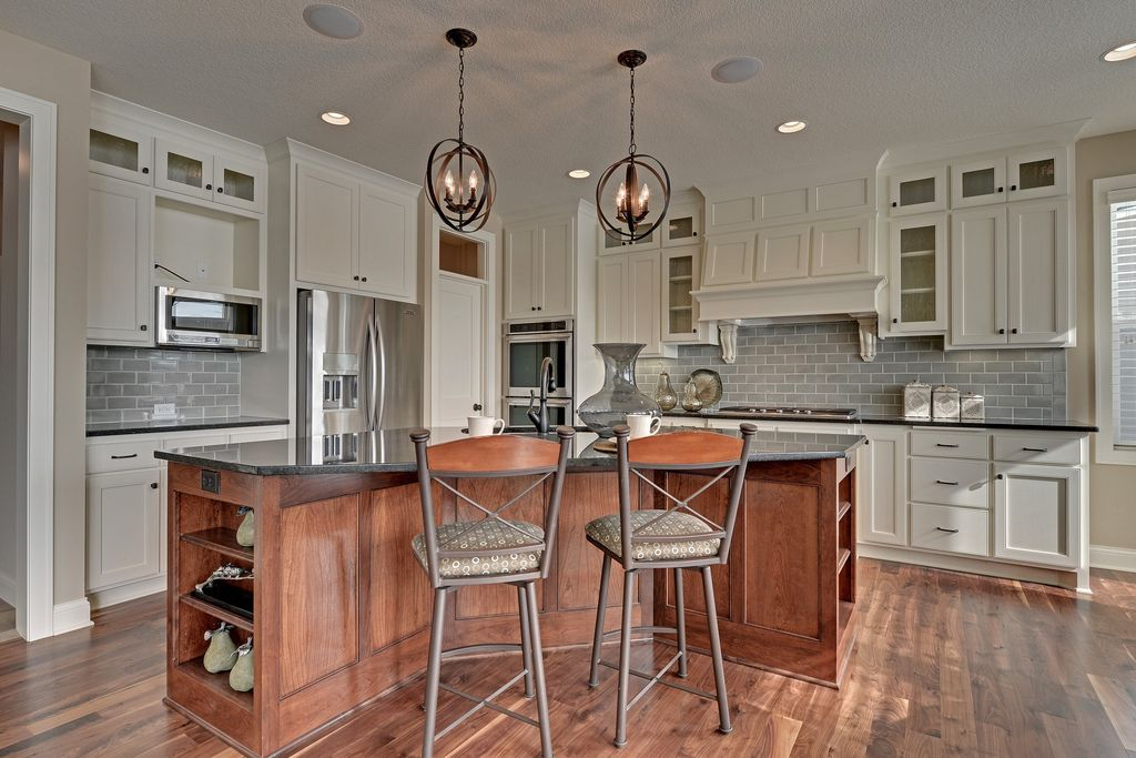 Craftsman Kitchen with double wall oven, can lights, Standard height, built-in microwave, Undermount sink, Glass panel, Paint