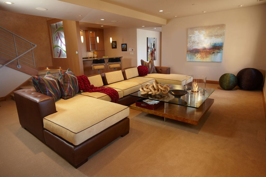 Contemporary Basement with can lights, Standard height, Carpet, Pendant light, Stained glass window, Exposed beam