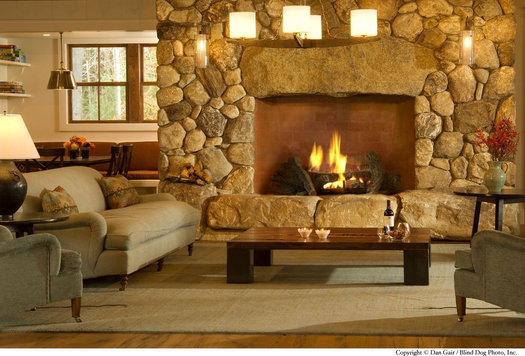 Rustic Living Room with Hardwood floors, Custom stacked stone fireplace, Chandelier, Fireplace, Wall sconce, Standard height