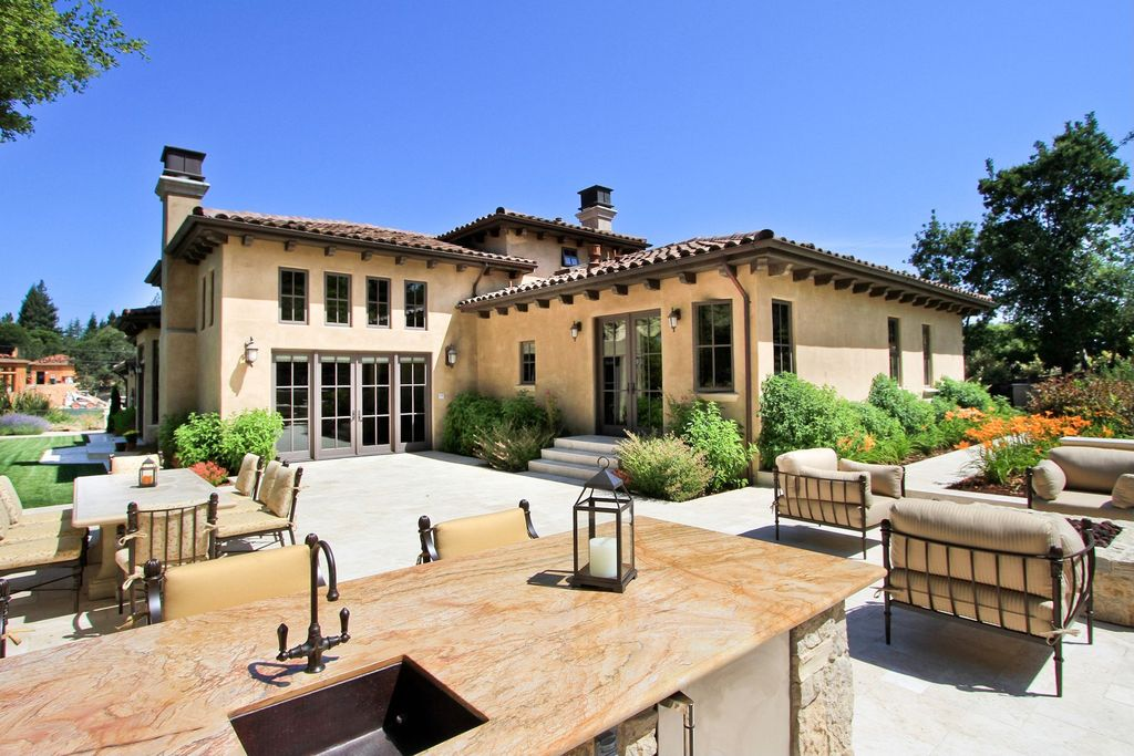 Mediterranean Patio with Outdoor kitchen, French doors, Fire pit, Casement, Raised beds, exterior stone floors