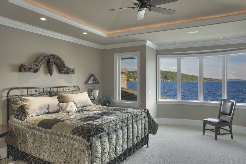 Traditional Master Bedroom with Standard height, Bay window, Crown molding, Carpet, Ceiling fan, Casement, can lights