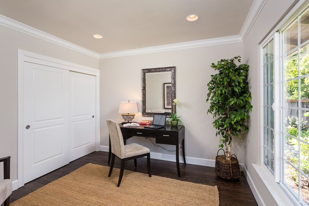 Traditional Home Office with Built-in bookshelf, Crown molding, Casement, Standard height, can lights, Hardwood floors