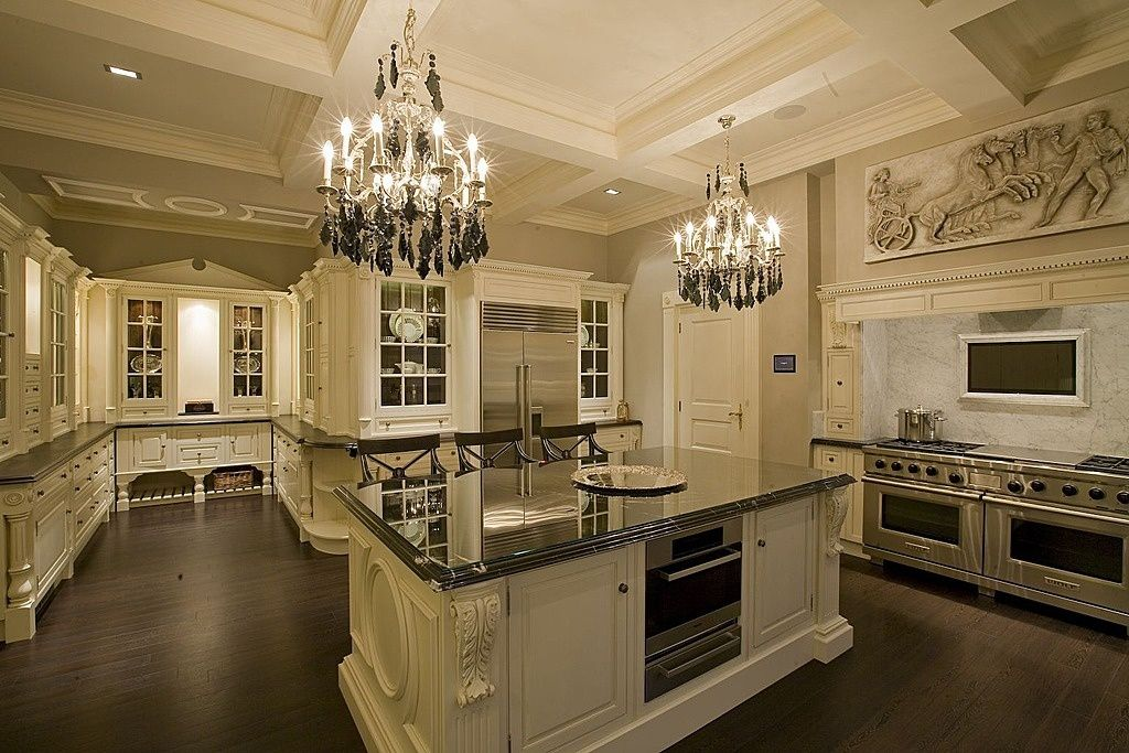 Traditional Kitchen with Custom cabinetry, Simple Granite, Breakfast bar, Framed Partial Panel, Standard height, Wall Hood