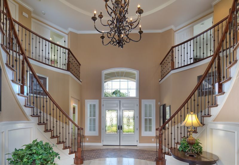 Traditional Entryway with French doors, complex marble tile floors, Chandelier, Crown molding, High ceiling, Transom window