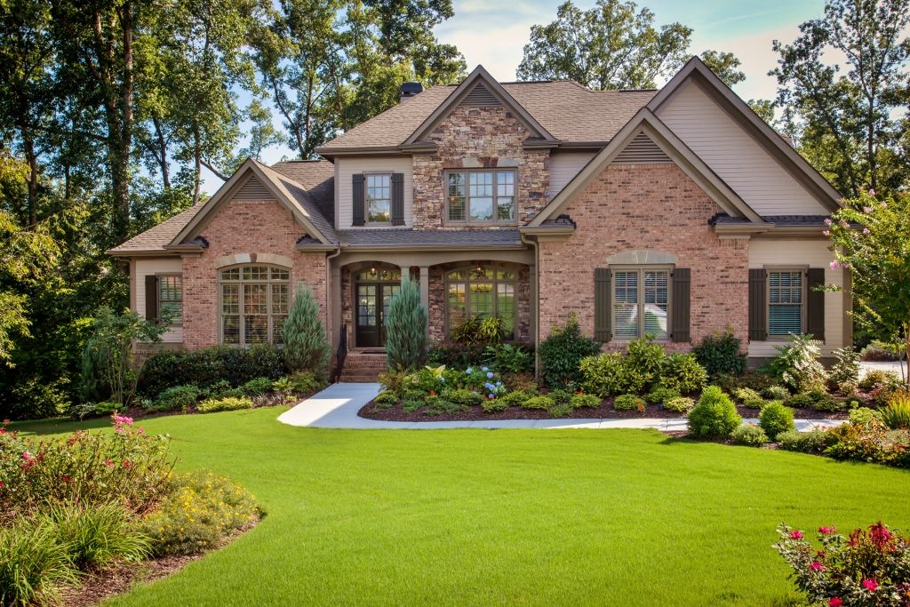 Traditional Exterior of Home with Exterior brick siding, Paint 2, Exterior shutters, Grass, Paint