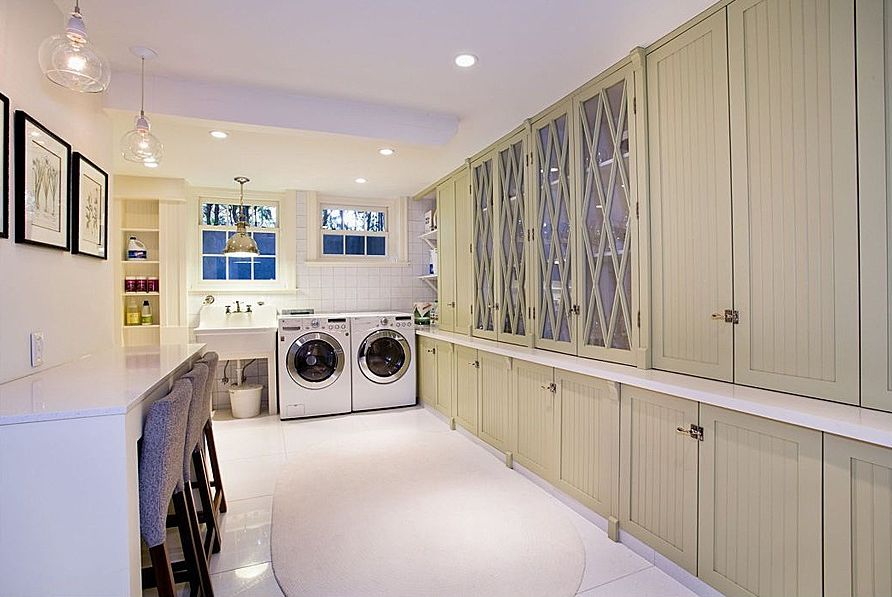 Country Laundry Room with Built-in bookshelf, double-hung window, laundry sink, can lights, Standard height, Concrete tile