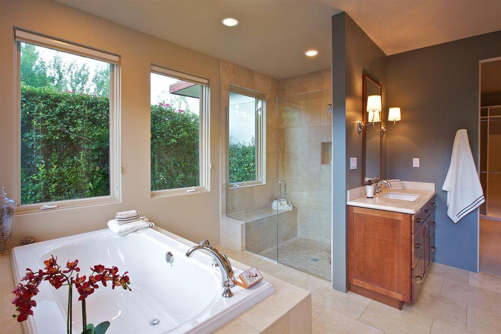 Modern Master Bathroom with Casement, Undermount sink, Paint, frameless showerdoor, partial backsplash, drop in bathtub