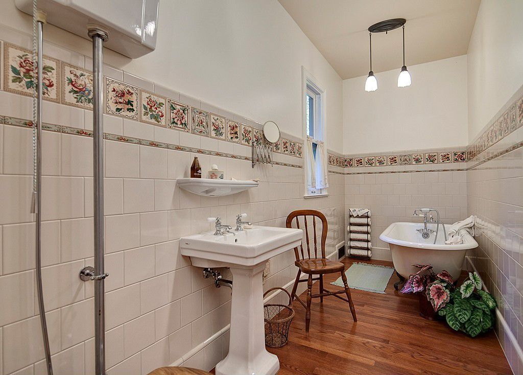 Country Full Bathroom with Full Bath, double-hung window, Bathtub, Hardwood floors, Standard height, Wall Tiles, Clawfoot