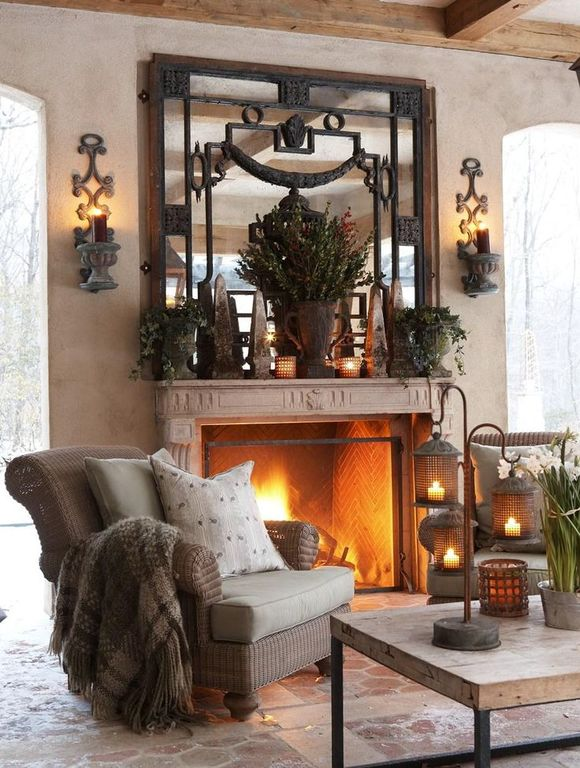 Mediterranean Living Room with Interlocking Pavers, Standard height, other fireplace, Fireplace, Exposed beam, Wall sconce