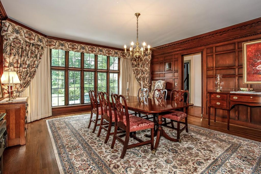 Traditional Dining Room with Casement, Hardwood floors, Crown molding, Standard height, Chandelier
