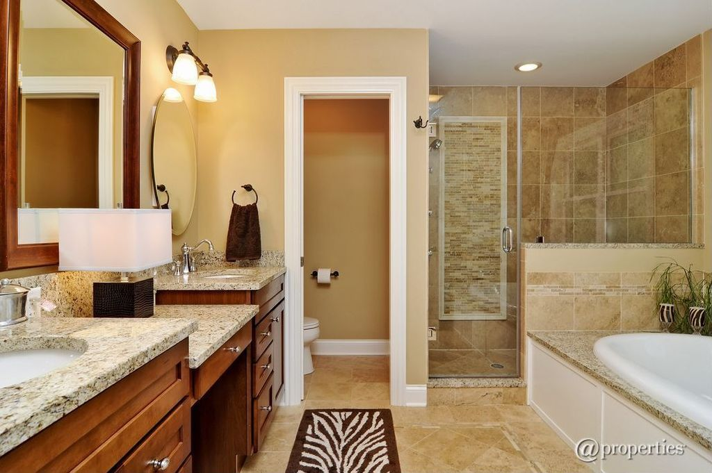 Modern Full Bathroom with Simple Granite, Flat panel cabinets, partial backsplash, drop in bathtub, Shower, can lights