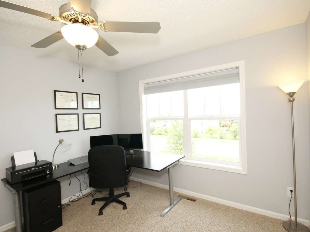 Traditional Home Office with double-hung window, Carpet, Ceiling fan, Standard height