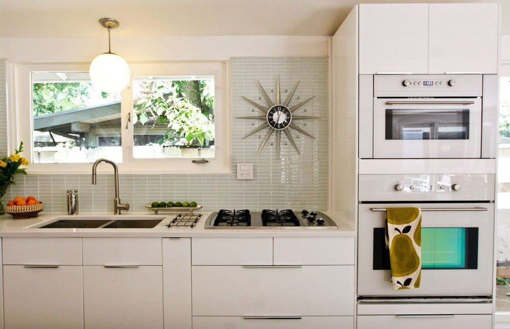 Modern Kitchen with Casement, Limestone counters, double wall oven, full backsplash, Standard height, electric cooktop, Flush