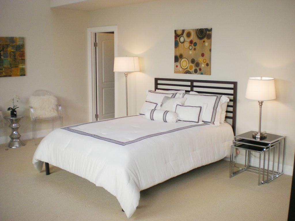 Contemporary Master Bedroom with specialty door, Carpet