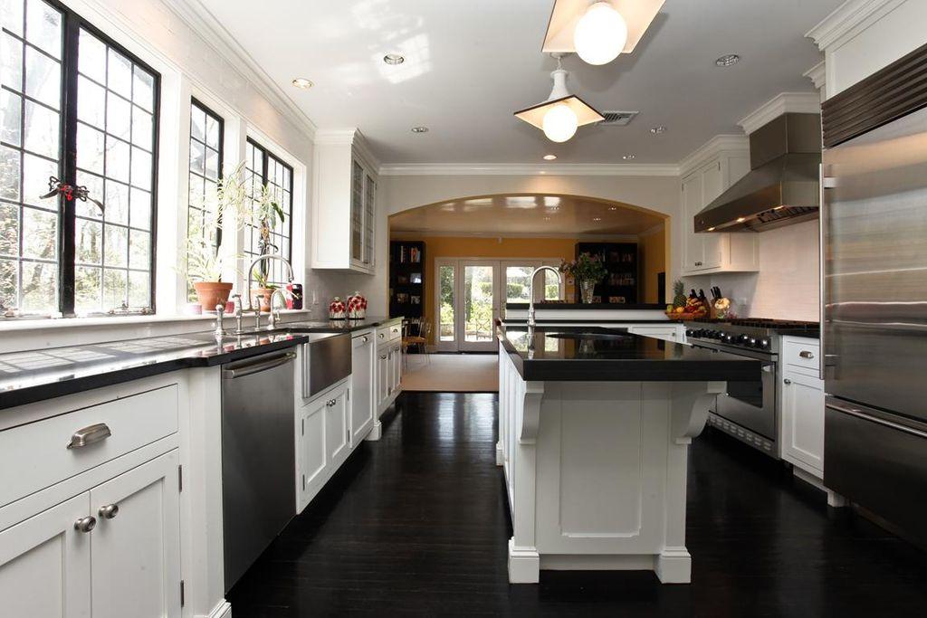 Traditional Kitchen with Casement, Kitchen island, dishwasher, Farmhouse sink, flush light, Built In Refrigerator, U-shaped