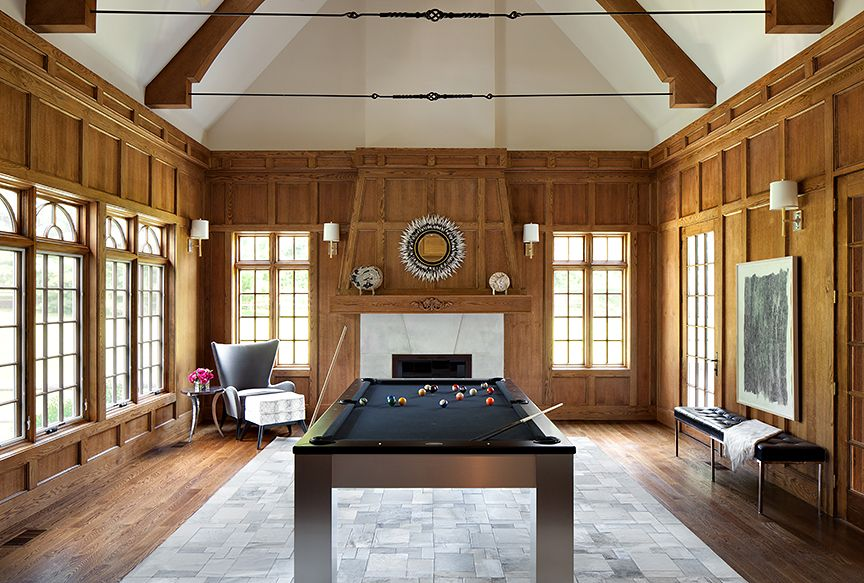 Contemporary Game Room with Hardwood floors, Exposed beam, French doors, Fireplace, stone fireplace, Wall sconce, Casement
