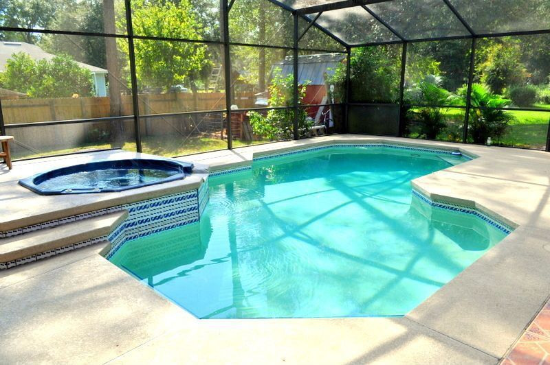 Traditional Swimming Pool with picture window, Pool with hot tub, exterior tile floors, Skylight, Indoor pool, Fence