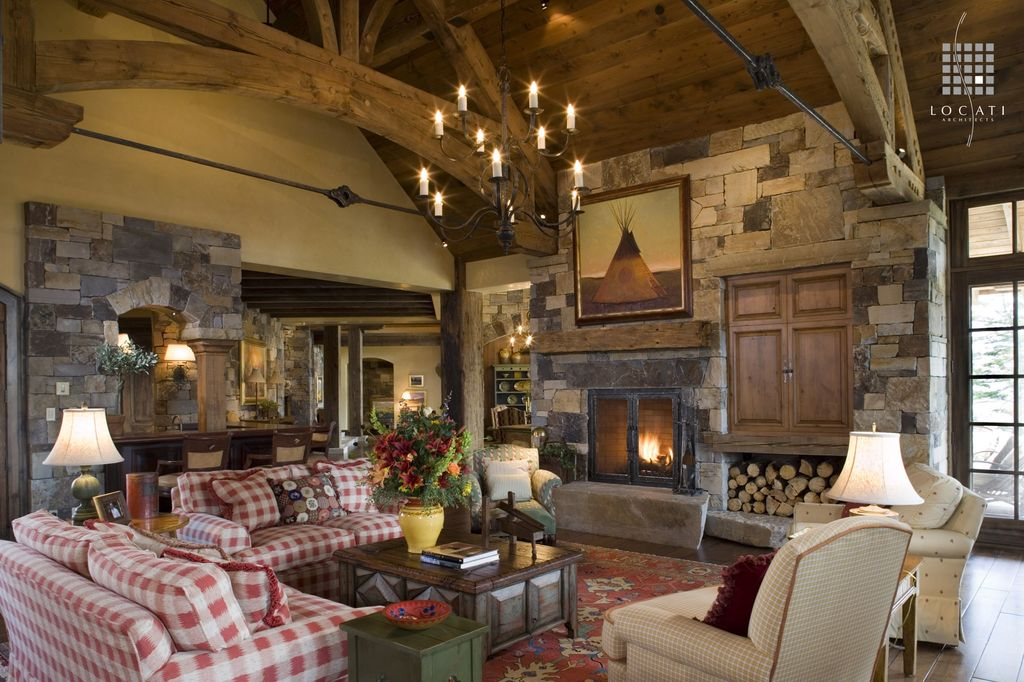 Country Living Room with Hardwood floors, flush light, French doors, Transom window, Fireplace, Cathedral ceiling, Chandelier