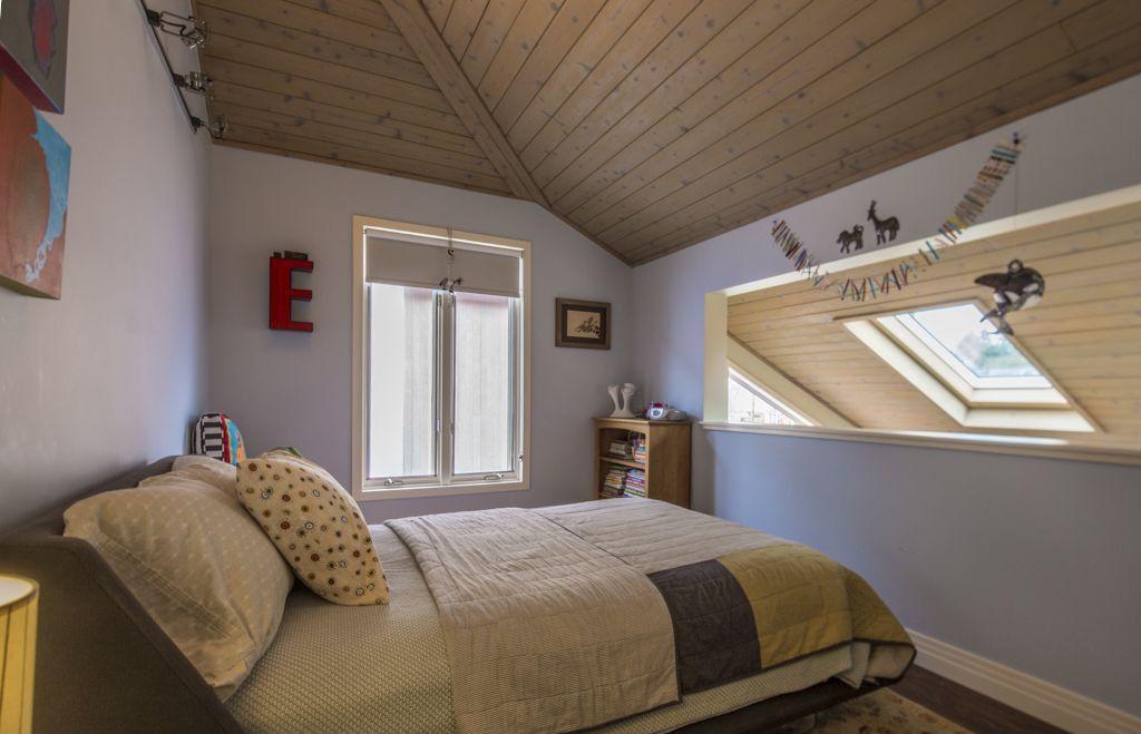 Contemporary Kids Bedroom with Casement, Standard height, Hardwood floors, flush light, no bedroom feature