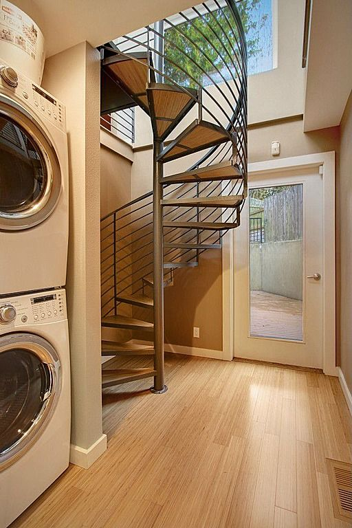 Contemporary Laundry Room with laundry sink, drop-in sink, French doors, Laminate floors, picture window, Standard height