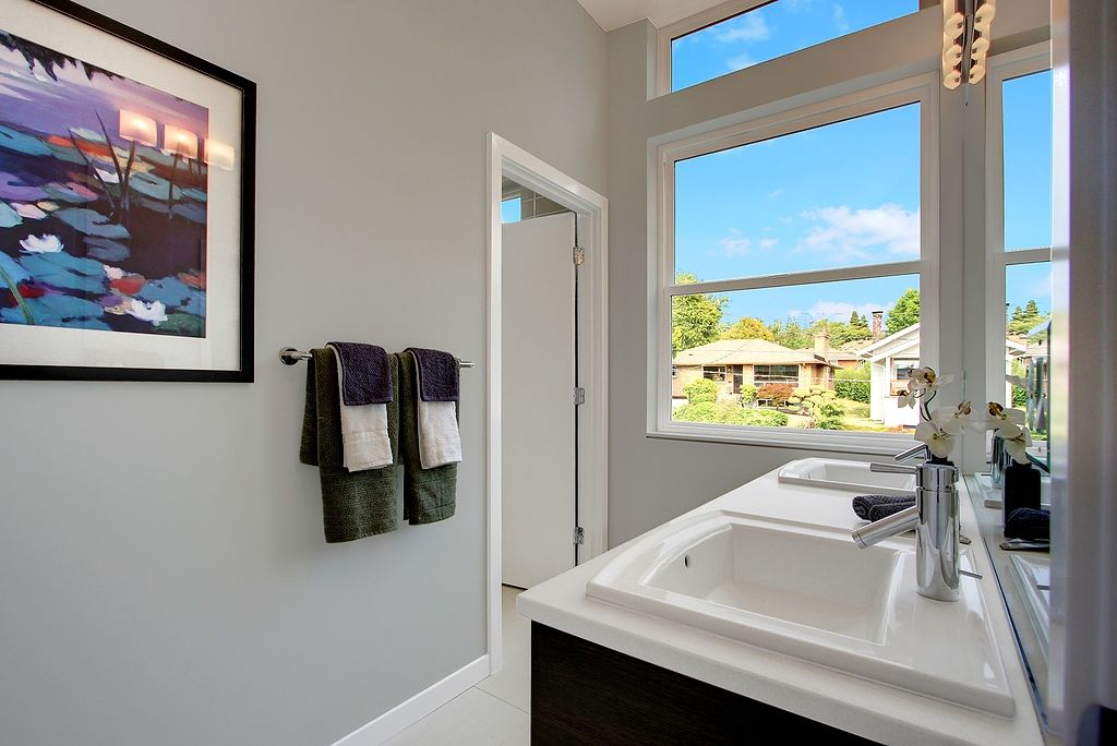 Modern Full Bathroom with Full Bath, Standard height, Limestone counters, drop-in sink, picture window, Wall sconce, Paint