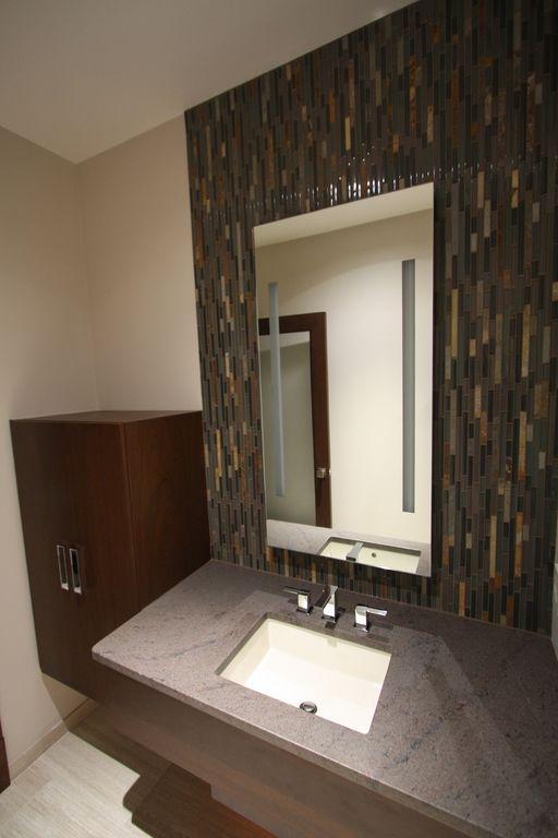 Contemporary Powder Room with Flush, stone tile floors, Simple granite counters, Standard height, full backsplash