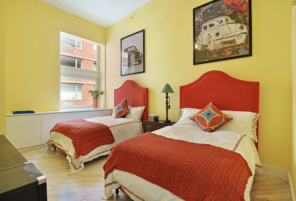 Eclectic Guest Bedroom with double-hung window, Built-in bookshelf, Hardwood floors, Standard height