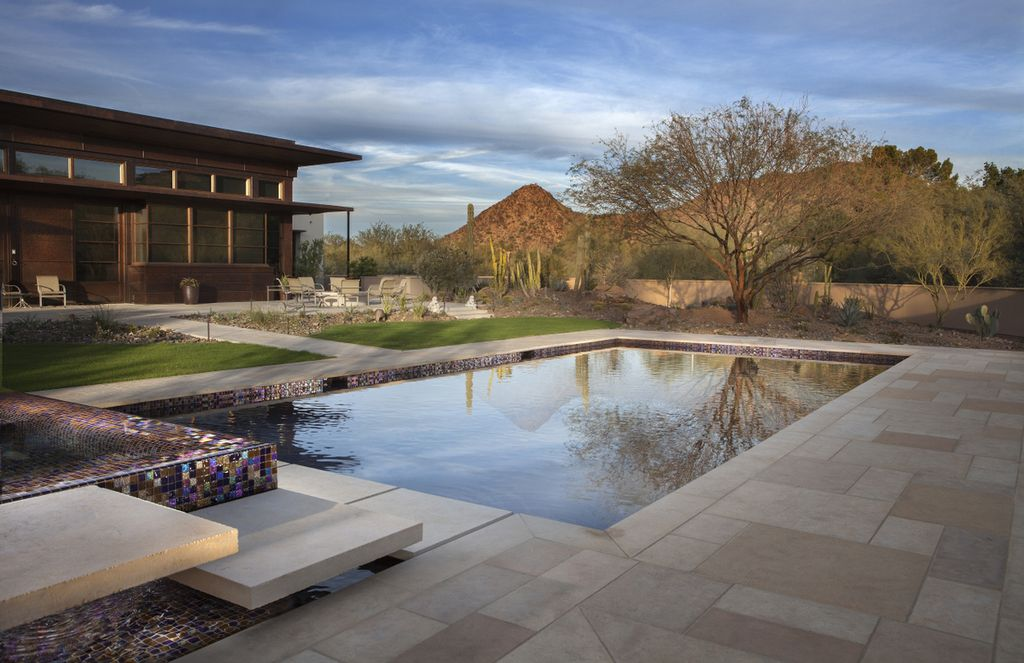 Contemporary Hot Tub with Pool with hot tub, Fence, Iridescent mosaic tiles, Natural stone tiles, exterior stone floors
