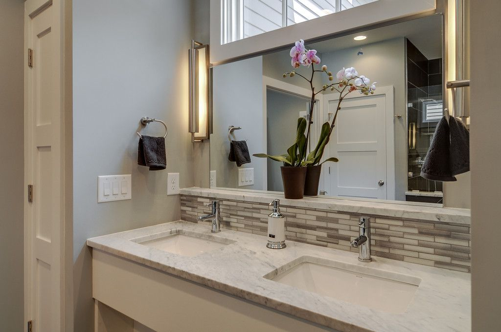 Traditional Master Bathroom with Paint 2, Wall sconce, specialty door, can lights, Ceramic Tile, full backsplash, Double sink