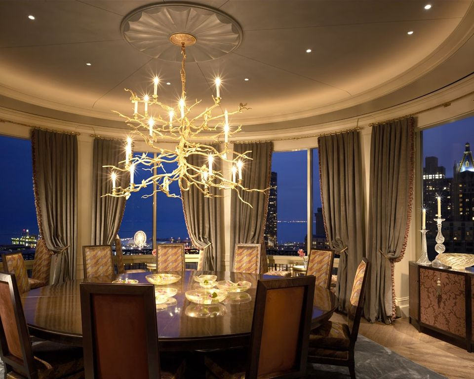 Contemporary Dining Room with Hardwood floors, Built-in bookshelf, Chandelier, Crown molding, Casement, can lights