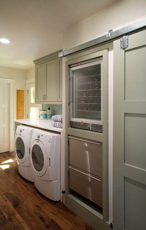 Modern Laundry Room with Built-in bookshelf, Kenmore 3.9 cu. ft. front-load washer & 7.0 cu. ft. dryer bundle, High ceiling