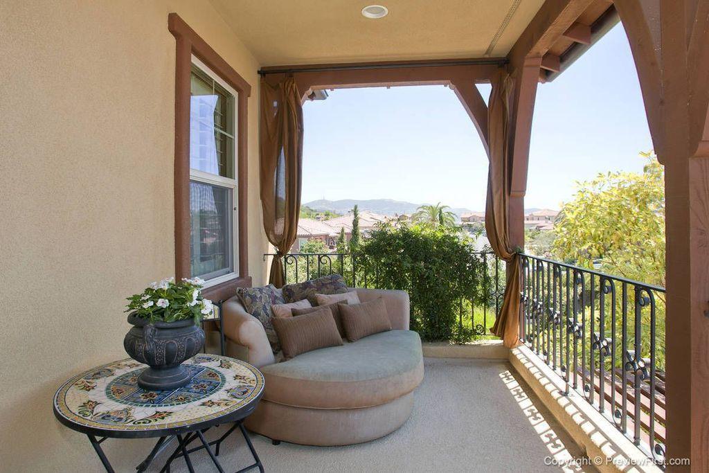 Mediterranean Porch with Deck Railing, Casement, exterior stone floors