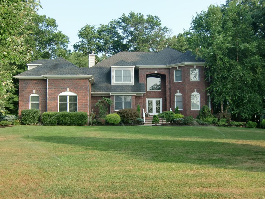 Traditional Front of Home with French doors, Raised beds, Casement, Arched window, double-hung window