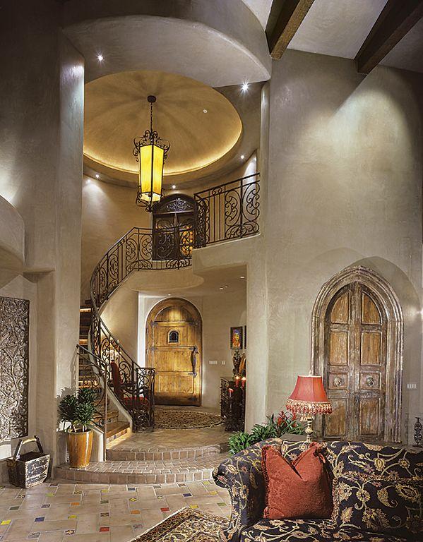 Mediterranean Entryway with can lights, limestone floors, High ceiling, Barn door, Loft, Pendant light