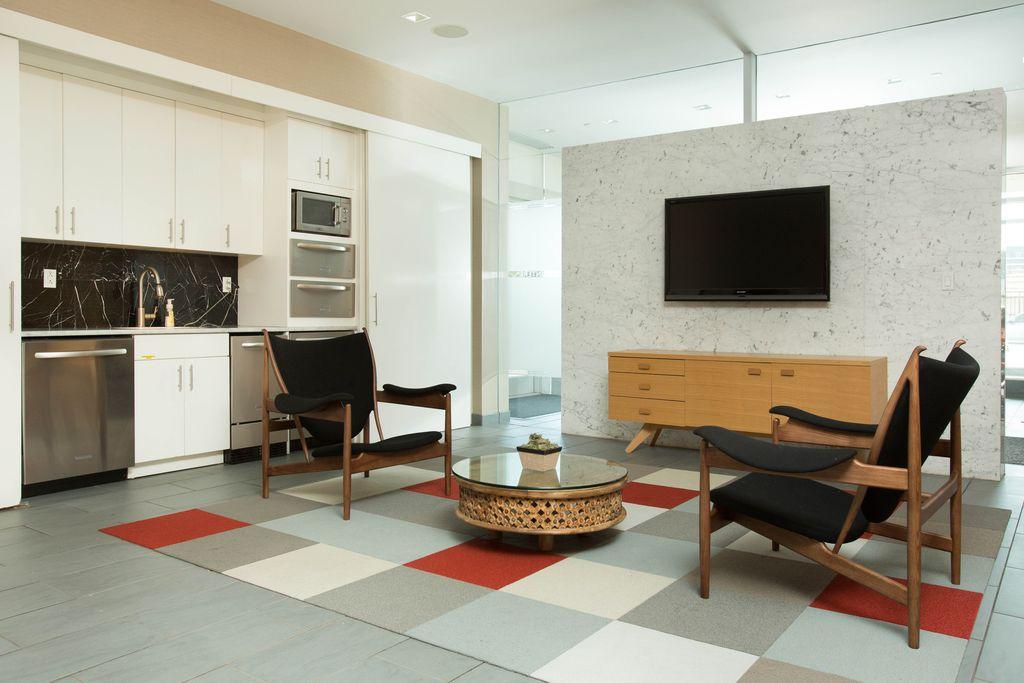 Modern Living Room with stone tile floors, can lights, soapstone tile floors, picture window, interior wallpaper, flat door