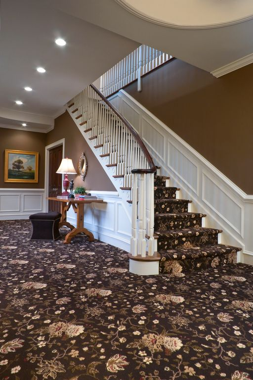 Traditional Hallway with six panel door, can lights, Standard height, Chair rail, Crown molding, Wainscotting, Carpet