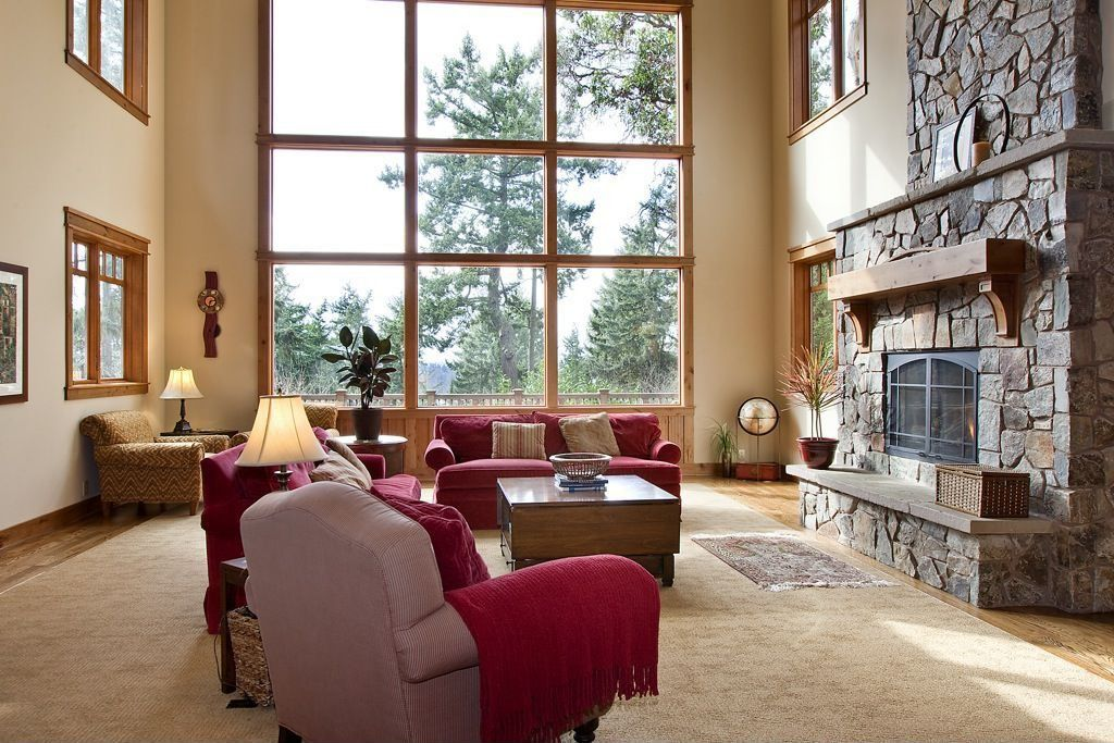 Craftsman Living Room with High ceiling, Casement, Fireplace, Hardwood floors, stone fireplace, picture window