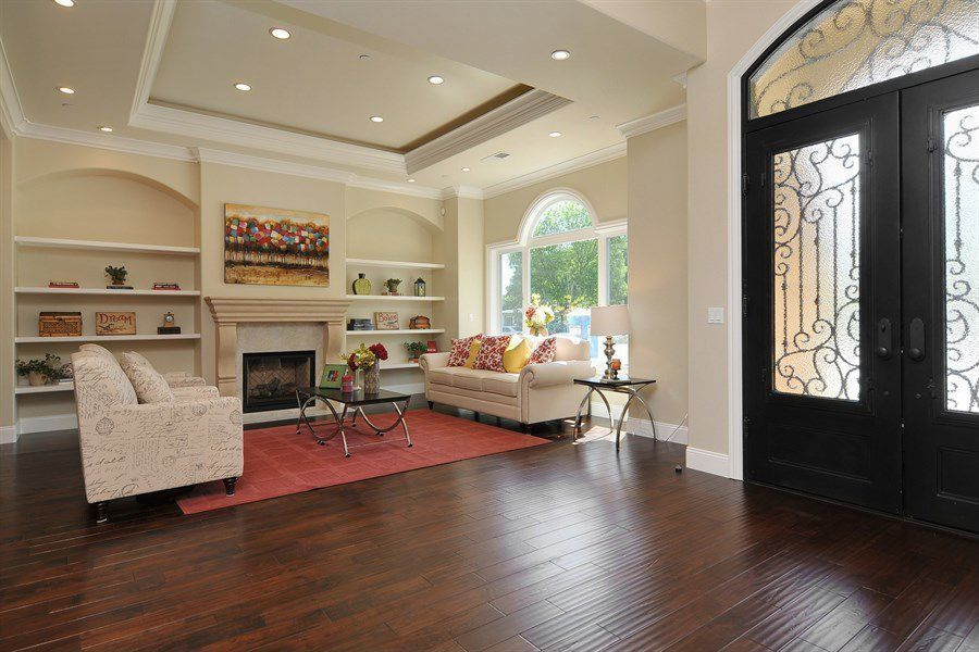 Traditional Living Room with Transom window, French doors, Built-in bookshelf, Hardwood floors, Fireplace, Standard height