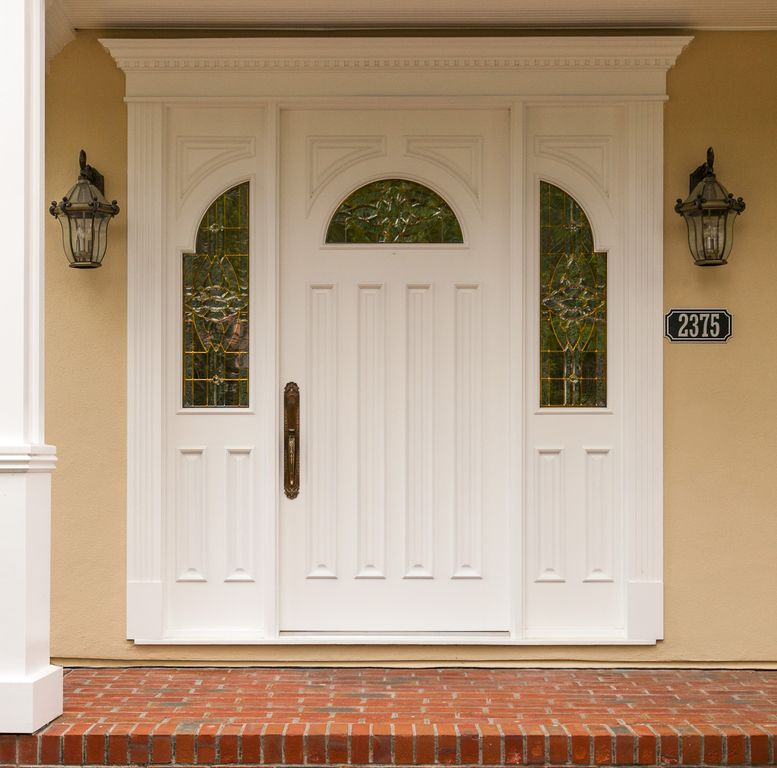 Traditional Front Door with six panel door, exterior brick floors, Pathway, Stained glass window