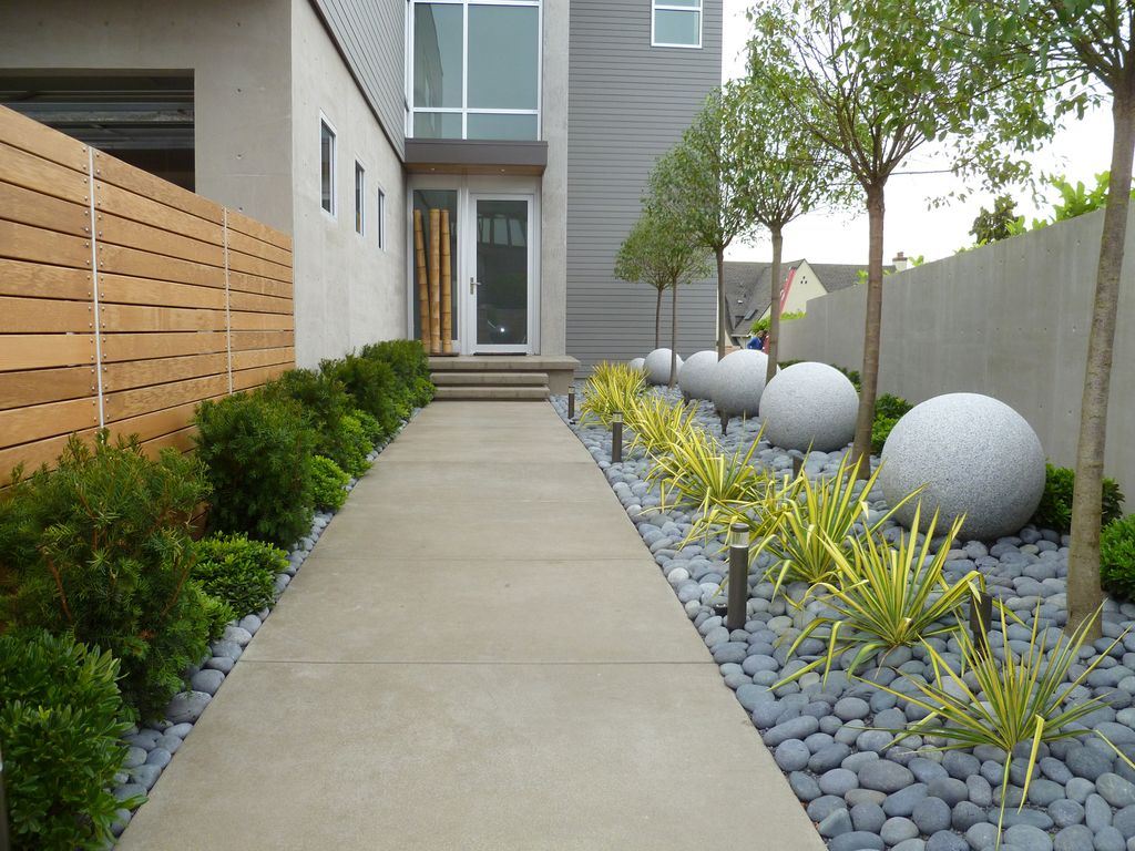 Contemporary Landscape/Yard with Casement, Pathway, exterior concrete tile floors, Fence, double-hung window, Raised beds