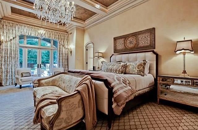 Traditional Master Bedroom with Chandelier, Transom window, French doors, Pendant light, can lights, Standard height, Carpet