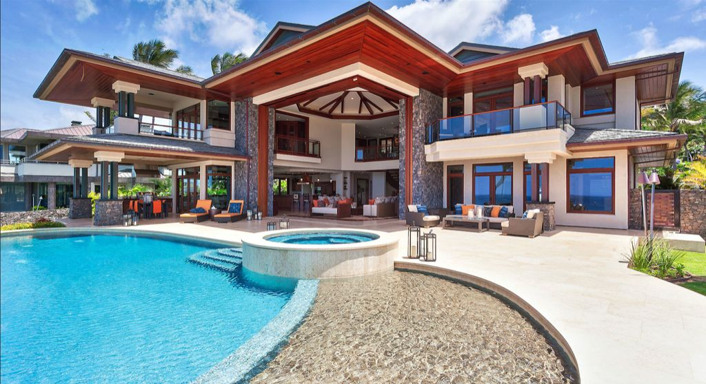 Tropical Swimming Pool with exterior stone floors, French doors, Pathway