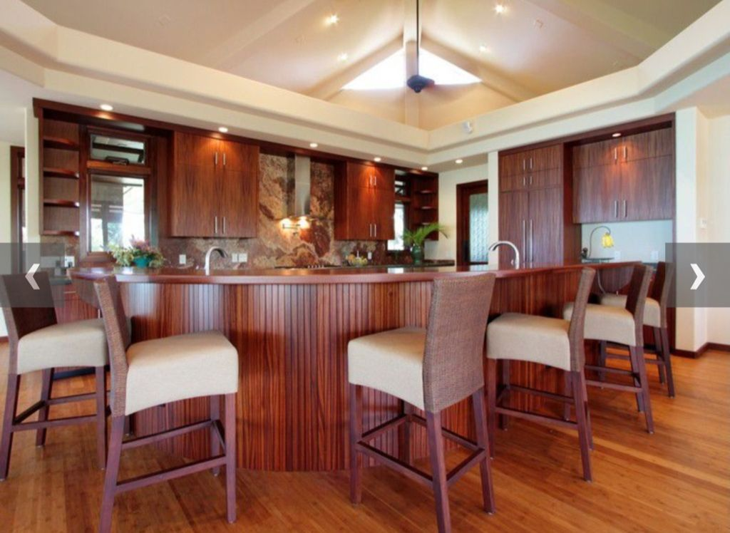 Contemporary Kitchen with full backsplash, Onyx, Skylight, can lights, Flush, High ceiling, electric cooktop, Wall Hood