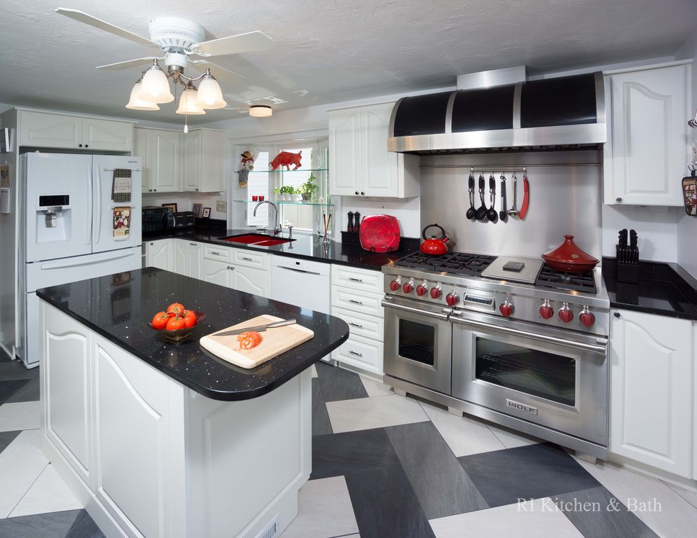Eclectic Kitchen with Built In Panel Ready Refrigerator, Ceiling fan, Bay window, Raised panel, Chandelier, L-shaped, Paint 1
